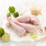 Free Range Chicken Drumsticks With Ginger, Demerara Sugar, Whole Lime, Lime Wedges and Scotch Bonnets